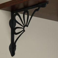 Daisy Cast Iron Shelf Bracket - Black Powder Coat by Whittington Collection. $19.95. Bring a touch of nature to your home with this Daisy Cast Iron Shelf Bracket. This durable, cast iron shelf bracket is available in two rustic finishes. Shown in Rust finish. Bracket dimensions: 9-3/8 L x 9-1/8 H. Bracket is 3/4 wide; 1-3/4 wide where the mounting screws are placed. Made of durable cast iron. Rust finish is actual oxidized iron, a living finish. Sold individually. Incl...