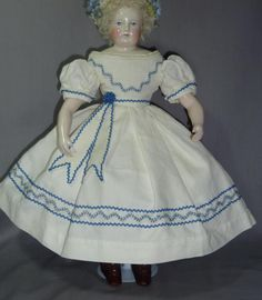 This is a lovely 1860's original off white cotton pique dress and cape in mode Enfantine.  It is suitable for an early French Fashion of about 15 to