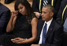 Emotion: President Barack Obama and first lady Michelle Obama attend an interfaith memoria...