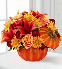 Beautiful Pumkin Arr, Lilies Roses and More