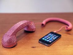 Imagine walking down the street, phone rings & you pull out an actual phone w/ cord out of your purse... AWESOME!