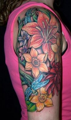 27e6e89885d4f tattoo upper arm women | An awesome flowers tattoo design are etched on  woman's arm.