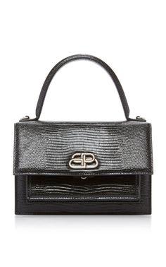 Balenciaga's 'Sharp XS' handbag boasts a satchel-inspired silhouette with modern sensibilities. Hermes Kelly, Fashion Bags, Designer Shoes, Balenciaga, Purses And Bags, Calves, Shoulder Strap, Satchel, Handbags