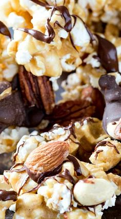Caramel Moose Munch Fancy Popcorn is crunchy, sweet, and chocolatey, caramel corn sprinkled with three kinds of nuts, and drizzled in two types of chocolate Snack Mix Recipes, Popcorn Recipes, Candy Recipes, Yummy Snacks, Sweet Recipes, Dessert Recipes, Yummy Food, Popcorn Snacks, Popcorn Balls