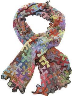 """Sophie Digard Wizard Scarf (in Multi): Designed in Paris and handmade in Madagascar. Hundreds of hand-crocheted puzzle pieces in myriad colors interlock to create this show stopper Wizard scarf that's edged in dark brown. Beautifully made in 100% linen. Dimensions: 13"""" x 52"""". $328.00"""