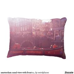 amsterdam canal view with front of cruise boat decorative pillow