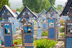 Picture of colorful wooden tombstones in the Merry Cemetery, Romania