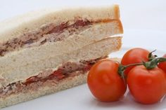 How to Keep Finger Sandwiches Fresh overnight - use wax paper, damp paper towel & an airtight plastic container, then place in the fridge