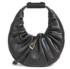 STYLECASTER | 2021 fashion forecast | 2021 fashion trends | fashion trends | fashion trends 2021 spring summer | fashion trends winter 2021 | 2021 Fashion Trend Forecast | classic bags | slouchy bags Fashion Forecasting, Fall Accessories, Designer Heels, Black Handbags, Leather Clutch, My Bags, Bucket Bag, Purses