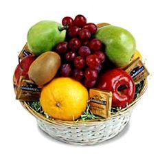 Fruit & Chocolate Basket Basket Includes:...Orange (3pcs)..Red Apple (3pcs)..Pears (3pcs)..Green Apple (3pcs)..Grapes (1/4k)..Toblerone Mini's..Swiss Chocolate..Small Kisses..