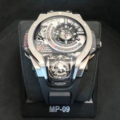 Hublot MP-09 ad: Price on request Hublot MP-09 Tourbillon Bi-Axis Titanium Limited 50 Pcs. Ref. No. 909.NX.1120.RX; Titanium; Manual winding; Condition 0 (unworn); Year 2017; New; With b