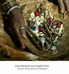 Africa | Items used in divining, by a Senufo soothsayer, including brass ornaments and cowrie shells.  Ivory Coast. | ©Carol Beckwith and Angela Fisher