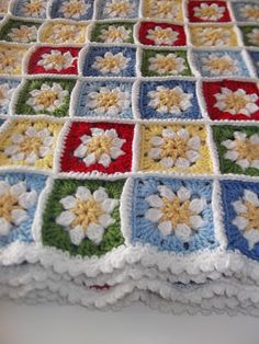 "Daisy square crochet. White flower with yellow middle. Light & medium blue,red,yellow & green...Then joined with white. Apple Blossom Dreams: ""Fit"" Daisy Blanket Ta Da!"