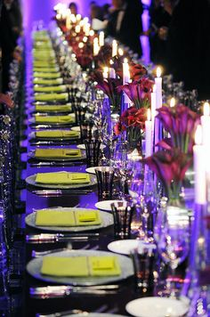 A long banquet table in purple and lime green.