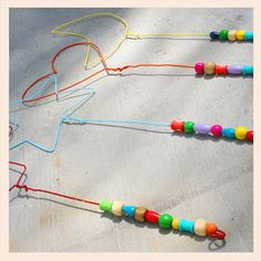 Make bubble wands out of wire hangers.use beads for colors of the olympic rings to go with Olympic VBS theme Homemade Bubble Wands, Homemade Bubbles, Homemade Bubble Solution, Bubble Birthday, Bubble Party, Bubble Fun, Wire Hanger Crafts, Wire Hangers, Wire Crafts