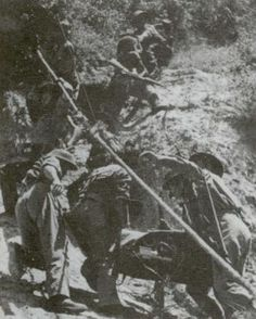 Polish soldiers transporting artillery pieces uphill. The Poles partially disassembled anti-tank artillery pieces, hauled them to the vicinity of the German bunkers, and fired at the enemy at point-blank range.