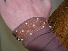 Closeup of sleeve. Madder dyed silk embroidery thread and small pearls.