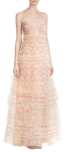 Voluminous yet delicate, this dreamy #Valentino tulle dress has trims of bright thread highlight on each and every ruffle. #STYLEBOP
