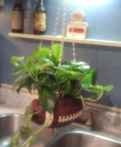 A hanging planter made from a old football! T's room