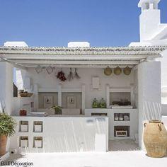 pretty little white outdoor kitchen for summer entertaining