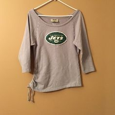 Jets off shoulder tie side 3/4 sleeve Never worn. One side ruched tie. Touch by Alyssa Milano Tops