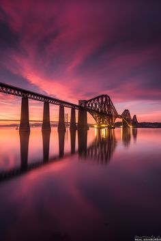 Forth Bridge. The Forth Bridge is a cantilever railway bridge over the Firth of Forth in the east of Scotland, 9 miles west of Edinburgh City Centre. It is considered an iconic structure and a symbol of Scotland. Beautiful Sunset, Beautiful World, Beautiful Places, Fife Coastal Path, Edinburgh City Centre, Skier, England And Scotland, Fife Scotland, Scotland History