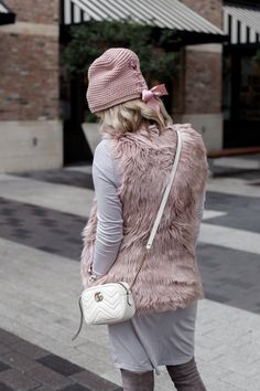 Faux fur vest outfit   winter outfit   chic outfit   OTK boots with dress   Uptown with Elly Brown