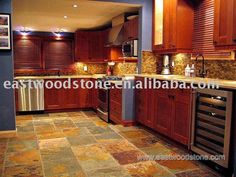 I've always wanted slate kitchen floors since I did a walkthrough of a house in Vegas