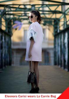 Eleonora Carisi wears La Carrie Bag