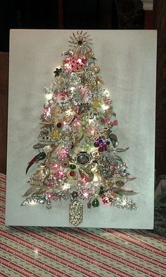 Vintage Jewelry Crafts I finally made my jewelry tree out of a lot of my mother in law's and mother's old costume jewelry. by shawna Costume Jewelry Crafts, Vintage Jewelry Crafts, Antique Jewelry, Noel Christmas, Christmas Jewelry, Christmas Ornaments, Handmade Christmas, Christmas Ideas, Vintage Christmas Trees