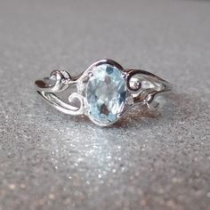 Sterling Silver Rhodium Plated Diamond & Aquamarine Oval Ring – Sparkle & Jade