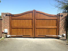 Timber Electric Gates Hull Electric or Manual Wooden Gates Wood Fence Gates, Fence Gate Design, Timber Gates, Garden Gates And Fencing, Front Gate Design, Privacy Fence Designs, House Gate Design, Wooden Gates, Fences