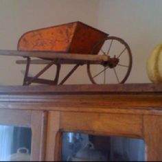Love this old toy wheelbarrow!