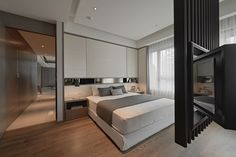 In one bedroom, form plays with function with ample storage above the bed, a unique swiveling TV, and plenty of light thrown by the large windows.