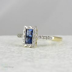 Art Deco Sapphire & Diamond Ring. Double Square Cut Sapphires in Engraved, Scalloped Edged Setting, Circa 1920s - 1930s.