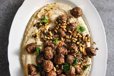Turkish kofta (meatballs) with cannellini and yogurt puree, and toasted pine nuts Lamb Recipes, Cooking Recipes, Yummy Recipes, Lentil Recipes, Cooking Ideas, Meat Recipes, Salad Recipes, Turkish Recipes, Ethnic Recipes