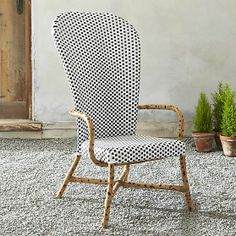 Fish High Back Woven Arm Chair in Outdoor Dining Chairs | Crate and Barrel