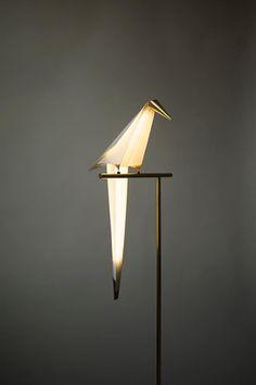 he Perch Floor Lamp is a balancing sculptural modern lamp made of folded paper a. he Perch Floor Lamp is a balancing sculptural modern lamp made of folded paper and brass. The lamp