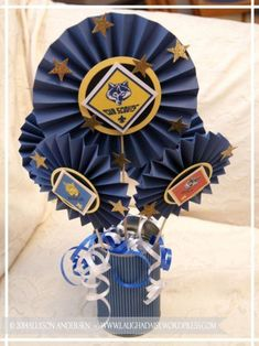 Blue & Gold Banquet Centerpieces. Medallions with Cub Scout patch logos.