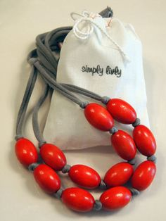 red wooden necklace with grey cotton jersey