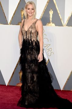 "<strong>Jennifer Lawrence in Dior.</strong> We would assume we were not the only ones who got a text from a family member asking, ""Wait, where was J. Law?!?!"" when the telecast began. But she is there! And this is a slightly more daring and funky look for the Oscar winner."