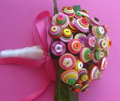 Not finding Directions, But use wire to thread through your stack of buttons, add grass and leaves, Then wrap/decorate with ribbon. Sounds like alot but for this size bouquet make about 60 button groups.