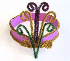 Get the kids in the mood for their own Mardi Gras parade by making a Mardi Gras Headpiece. Purple, Gold and Green are Mardi Gras colors and easy to make.