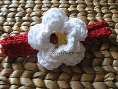 This handmade crochet baby headband is cute as a ladybug!  Perfect for picnics, beach visits and all of the fun that Summer has to offer!    Please stop by my shop at www.etsy.com/shop/sweetheartsandsoles for more handmade baby and toddler accessories!