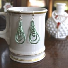 Make a pair of these easy earrings in any color your want. Inspired by oriental knotting handicrafts.