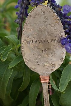 plant marker:  stamped spoons as plant markers, 36 piece set of stamps available at http://www.harborfreight.com/catalogsearch/result?q=metal+stamp+kit for about nine dollars