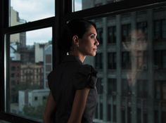 90285075-woman-looking-over-city-reflected-in-window-gettyimages.jpg (478×356)
