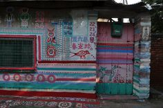 Paintings by 86-year-old Haung Yung-Fu in the Rainbow Village, Taichung, Taiwan.