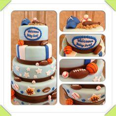 Baby boy baby sports themed baby shower cake. Blue, white, stars, stripes, baseball, basketball, football, baseball cap, bat.   www.facebook.com/cakeitorleaveitcakesbymarianne