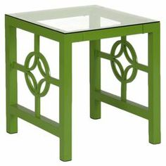 "Display fresh blooms or rest your morning mug of Earl Grey on this stylish coffee table, showcasing an open steel frame and sleek glass top.    Product: End table   Construction Material: Powder-coated steel frame   Finish: Green   Features:Plastic bumpers to protect glassDesigned with minimal screw exposurePlastic leg glides to prevent scratching   Dimensions: 20"" H x 24"" W x 24"" D"